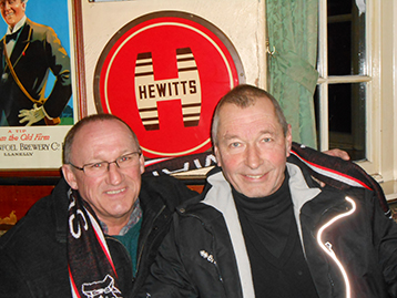 The Chairman and The Dean touch the Hewitts sign for good luck.