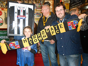 Sophie welcomes Harrogate Town representatives Andy Harrison and Mick Harland.