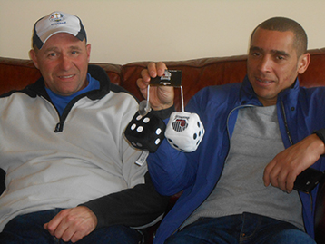 Together with Wes they proudly display their memento's and trophies - the famous Ebony & Ivory dice.