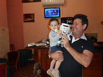 At the Taverna el Pescador, owner Eduardo took the opportunity to introduce his son to Mattie.