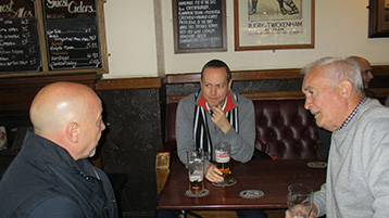 Histon Mariners, Gary the Hammer and Kevin the Web listen intently to the Presidents pre-match briefing.